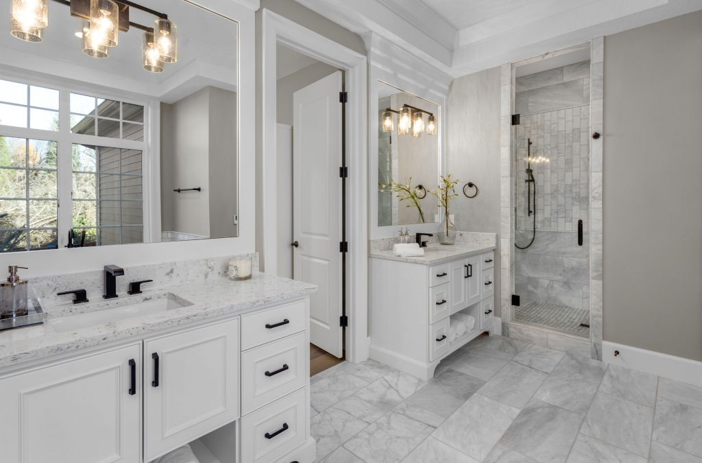 Bathroom with marble floors, and tiles. Modern white color scheme with light gray walls.